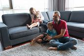 Happy family. Father, mother and children playing a video game Father and son playing video games to poster