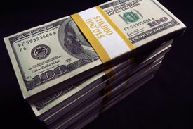 foto of one hundred dollar bill  - Stack of Ten Thousand Dollar Piles of One Hundred Dollar Bills on a black background - JPG