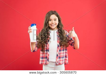 poster of Fresh It Up. Small Child Long Hair. Girl Active Kid With Long Hair. Shampoo Bottle. Dry Shampoo. Eas