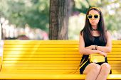 Bored Woman Waiting For Her Date Alone On A Bench poster