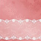 pink and white background with black lace