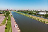 Rowing Canal Illuminated By Bright Sunshine. Panoramic View. Shooting From Above, Aerial Filming. Ol poster