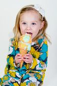 little girl eating ice cream cone