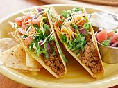 Tacos on a platter with tortillas shot with natural light - mexican food
