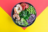 Poke Bowl With Red Shrimps And Vegetables In The Dark Bowl In The Center Of The Colorful  Background poster