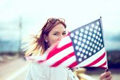 Happy Young Patriot Modern Urban Woman Holding Usa Flag Portrait, Depth Of Field, Selective Focus poster