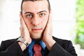 Businessman turning a deaf ear