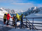 Skiers looking at view: Valle Blanche Glacier, Chamonix, France.