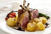 Rack of lamb dinner, with crushed roasted potatoes, cherry vine tomatoes, baby green beans and a balsamic jus.