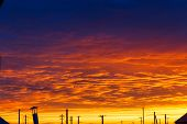 Beautiful Sunset. Colorful Dramatic Sky At Sunset. Layered Rain Clouds. Bright Blue Orange Backgroun poster