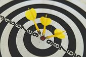 Three Yellow Dart On Board Right Direction Hit Target Goal. Competition Game To Win Focus On Achieve poster