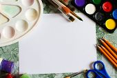 Art Supplies On Desk. Blank Sheet Of Paper On Blue Office Desk. Brushes, Gouache,clean Sketchbook Sh poster