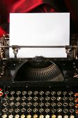 pic of short-story  - Old type writer with a blank sheet of paper - JPG