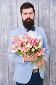 To Say I Love You. Womens Day. Flower For March 8. Spring Gift. Bearded Man Hipster With Flowers. Be poster