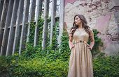Beautiful Teen Girl In Glamorous Golden Dress Going To Her Prom Or Dance poster