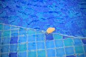 Shallow Wadding Pool Water In Swimming Pool. Pool Design With Small Ceramic Tiles. Repeating Dark De poster