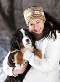 Bernese sennenhund puppy and girl.