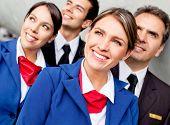 stock photo of cabin crew  - Portrait of friendly airplane cabin crew looking happy - JPG