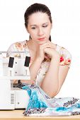 Woman In Summer Blouse Darning On The Sewing Machine