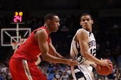 Penn State's Talor Battle is guarded by Evan Turner#21 in