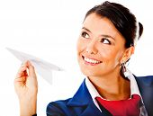 Air hostess holding a paper airplane - isolated over a white background
