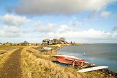 Wide view at the IJsselmeer with traditional houses in the Netherlands