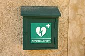 stock photo of defibrillator  - Green box with defibrillator  - JPG