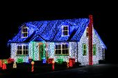 Christmas Lights Show Display On House At Night