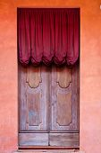 pic of screen-porch  - wooden door with red curtain of medieval house in Bologna Italy - JPG
