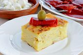image of piquillo pepper  - Tapas selection of a square of Spanish Tortilla with roasted red peppers in olive oil and potato salad to the rear  - JPG