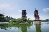 Banyan Lake Pagodas, Guilin, China ,one represents the sun, the other the moon