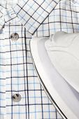 Electric Iron And Checkered Shirt