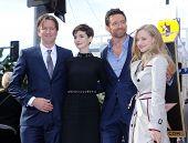 LOS ANGELES - DEC 12:  Tom Hooper, Anne Hathaway, Hugh Jackman & Amanda Seyfried  arriving to Walk of Fame Honors Hugh Jackman  on December 12, 2011 in Hollywood, CA