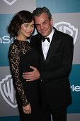 LOS ANGELES - JAN 15:  DANNY HUSTON & DATE arriving to Golden Globes 2012 After Party: WB / In Style
