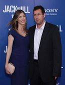 LOS ANGELES - NOV 06:  ADAM SANDLER & WIFE JACKIE arriving to