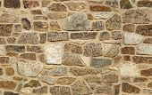 stock photo of granite  - seamless ashlar old stone wall texture background - JPG