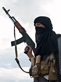 Picture of muslim rebel with ak assault rifle.