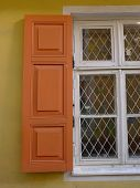 orange blinds on a window