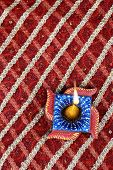 stock photo of swastik  - Handmade Indian Diwali Diya in Swastik Shape - JPG