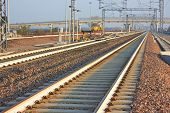 foto of railroad yard  - Empty Railroad track vanishing into the distance - JPG