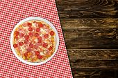 pic of take out pizza  - Pepperoni pizza on wood table in pizza restaurant - JPG