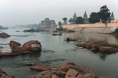 Ghat And Bundela Cenotaphs Appear In The Early Morning Over Foggy Betwa River, India's Orchha.