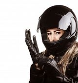 Closeup portrait of blond woman wearing motorsport outfit, isolated on white background, shiny black
