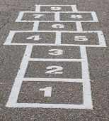 stock photo of hopscotch  - Hopscotch game grid in playground on cement - JPG