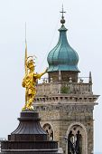 Golden statue at the top of the building in the upper city of Bergamo, Lombardy, Italy