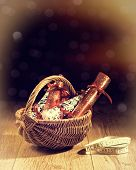 Homemade Christmas crackers in basket with vintage feel and bokeh background