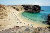 pic of papagayo  - people relacing sunbathing and swimming at smaller bay of Papagayo beaches at Lanzarote - JPG