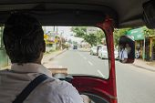 A Tuk Tuk Driver On The Road
