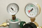 stock photo of gage  - Oxygen in tank exhausted and indicated on gages to refill - JPG