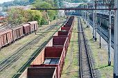 stock photo of railroad car  - many railroad cars and tanks standing in rails - JPG